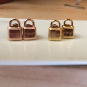 Post Micheal Kors lock earrings